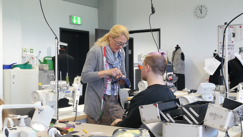 DUSSELDORF, GERMANY - MAY 26, 2016: Practical training for bespoke tailor in the textile department of the vocational school. | Shutterstock HD Video #21699160