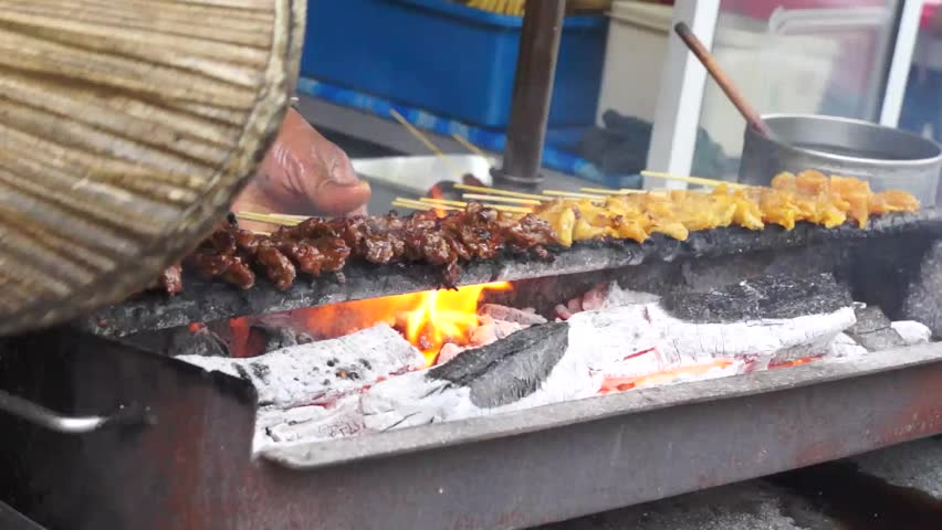 Traditional style beef satay on bamboo stick grilled on hot coal flame.