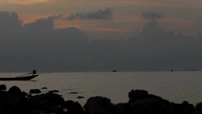 fishing boat and the sea - silhouettes  - HD stock video clip