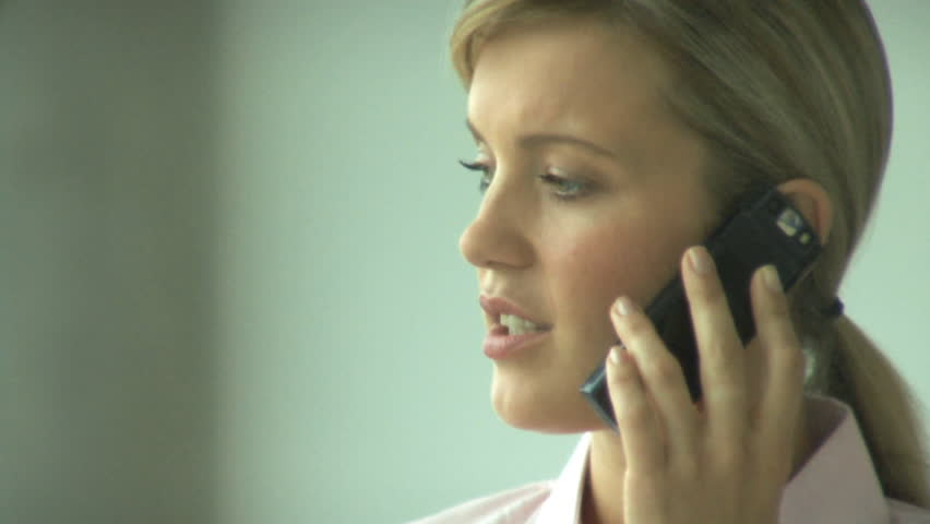 CLOSE UP FEMALE ON PHONE IN OFFICE - HD stock video clip