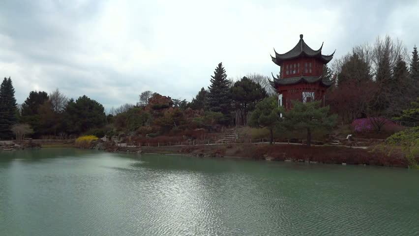 Old buddhist temple located near a calm lake.