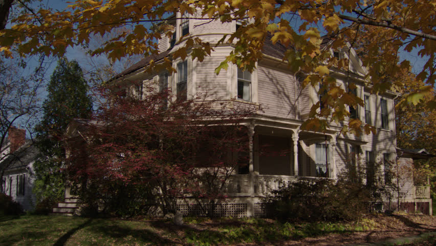Day tilt tree right front corner side beige wood clapboard house , wrap around porch, bay windows, dormers, turret, autumn, fall trees, back porch, breezy, (Oct 2012)