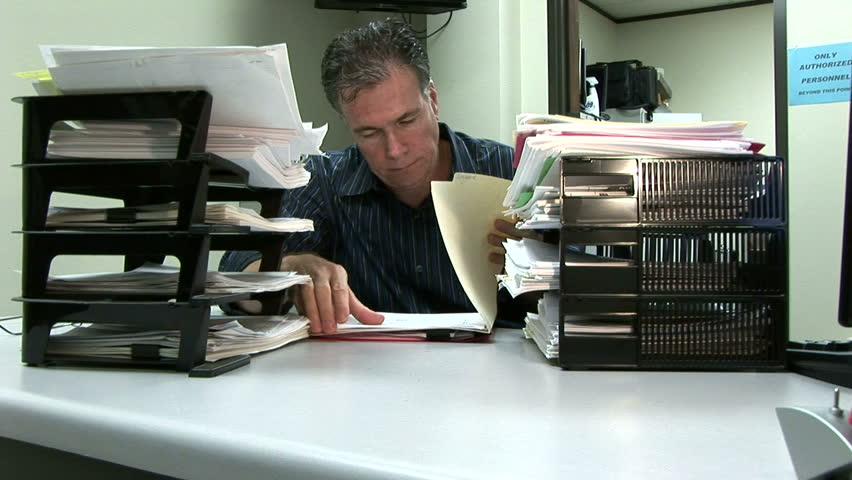 A man at his desk showing signs of being overworked - HD stock footage clip