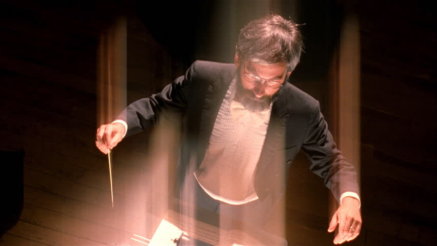 Orchestra conductor waves baton - HD stock video clip