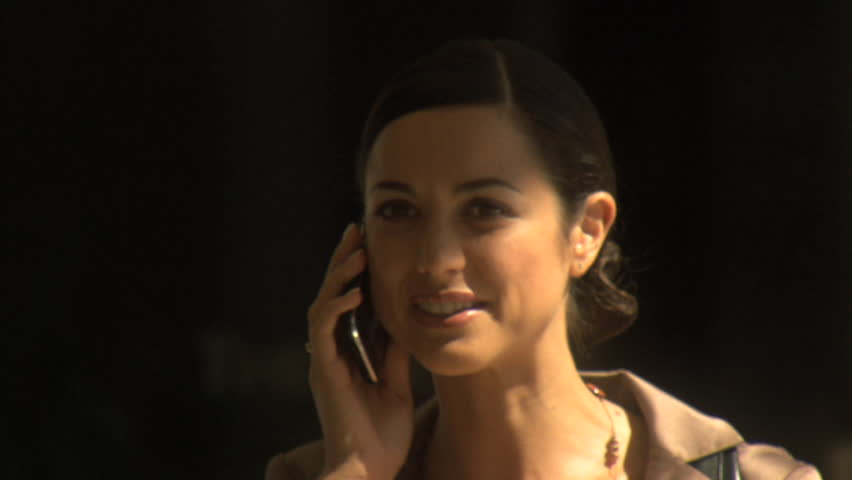 MEDIUM CLOSE UP OF A BUSINESSWOMAN USING A CELL PHONE - HD stock video clip