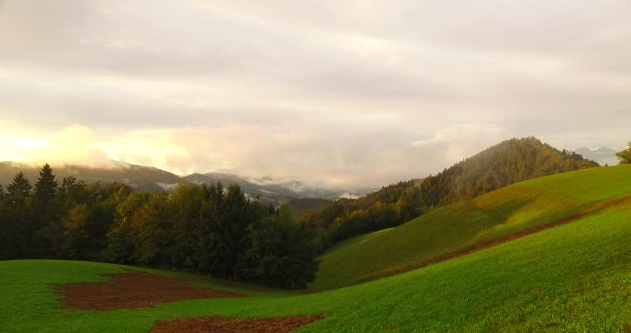 Fog and clouds over green pastures in early autumn. | Shutterstock HD Video #22083649