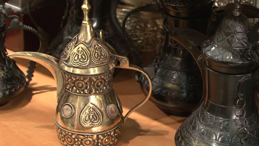 Dallah (coffee pot). CU on traditional dallahs or brass coffee pots used to serve Arabic coffee. (Dubai, UAE-2010) | Shutterstock HD Video #22090849