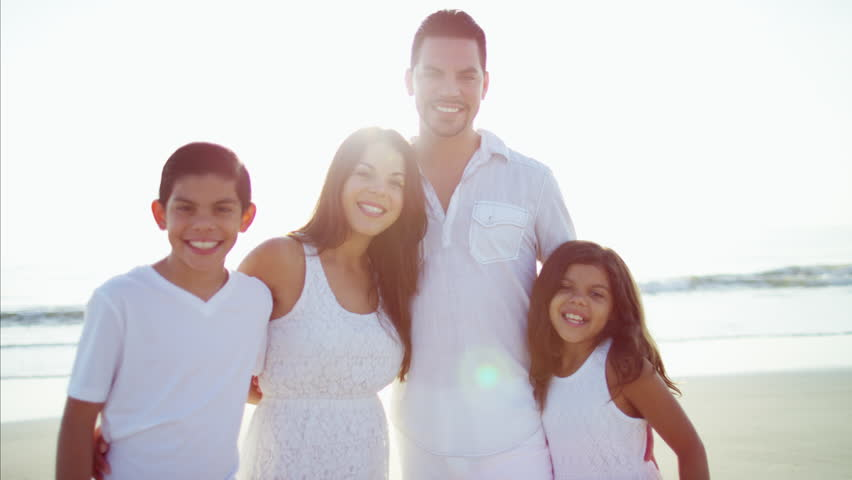 Portrait laughing Hispanic family togetherness travel waving hands Summer holiday outdoor beach flare sun RED DRAGON | Shutterstock HD Video #22097266