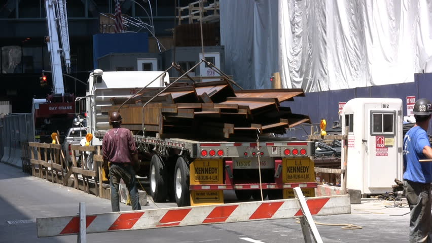 Metal Beams Being Offloaded From A Transport Truck At A New York City Construction Site - HD stock footage clip