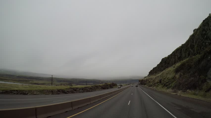 Elevated POV driving shot on I84 Eastbound along the rainy Columbia River Gorge in  Oregon, USA. 12/05/16  | Shutterstock HD Video #22132870