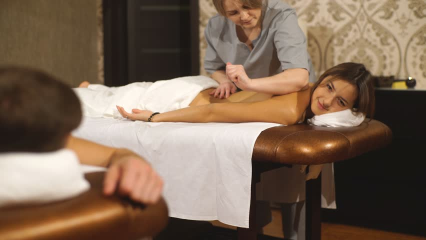 a young couple relaxes on couples massage in a posh Spa center #22148818