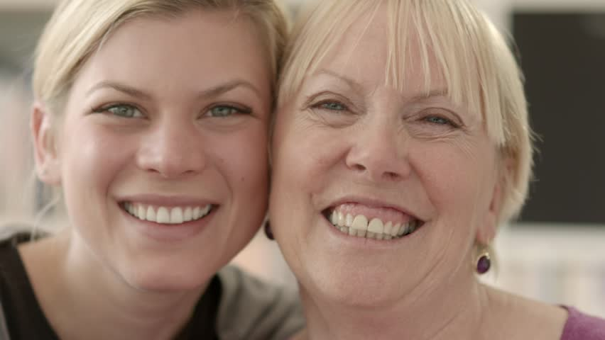 Women portrait with happy mom and daughter smiling, hugging, showing love and affection. Close up