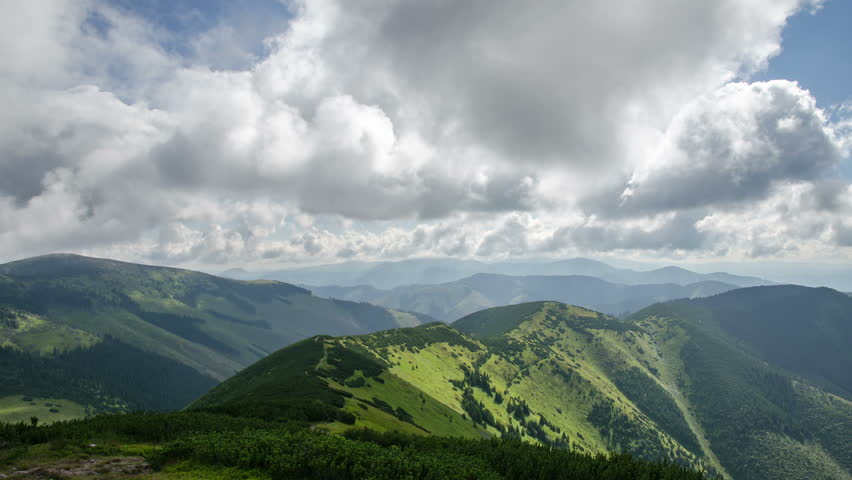 Beautiful white clouds in sky flying over green landscape in mountains time lapse | Shutterstock HD Video #22208119