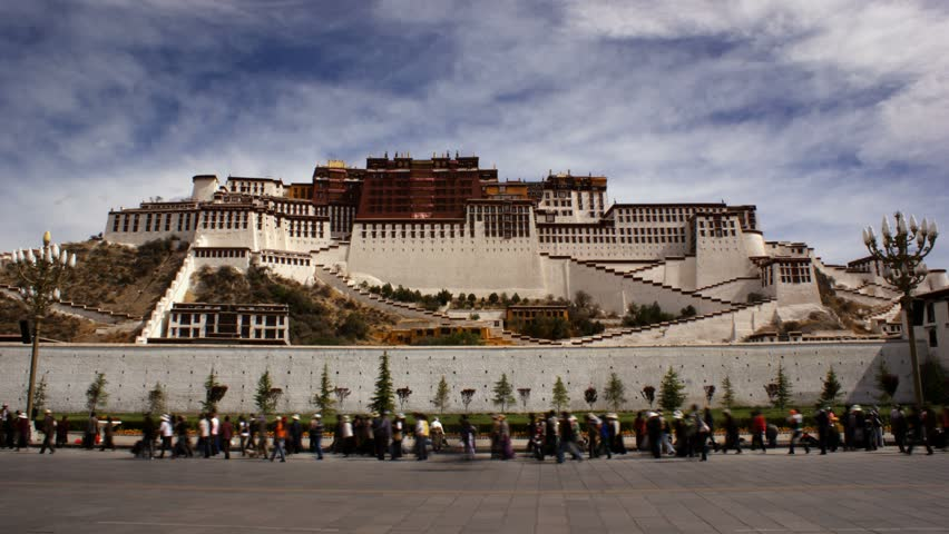 Lhasa, Tibet - Circa 2010: The Potala Palace in 2010.  Close up timelapse of Potala Palace with pedestrians in Lhasa, Tibet. - HD stock footage clip