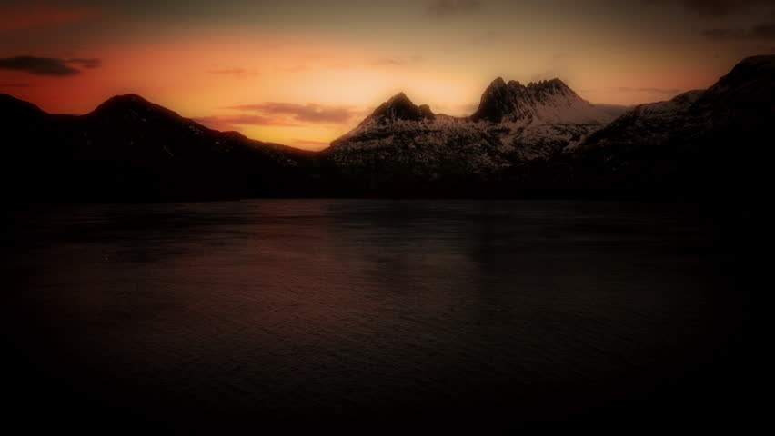 Lake by the Mountain at Sun set animated stock footage. An animation of a large lake with a snow capped Mountain in the background at Sun set.  #22238008
