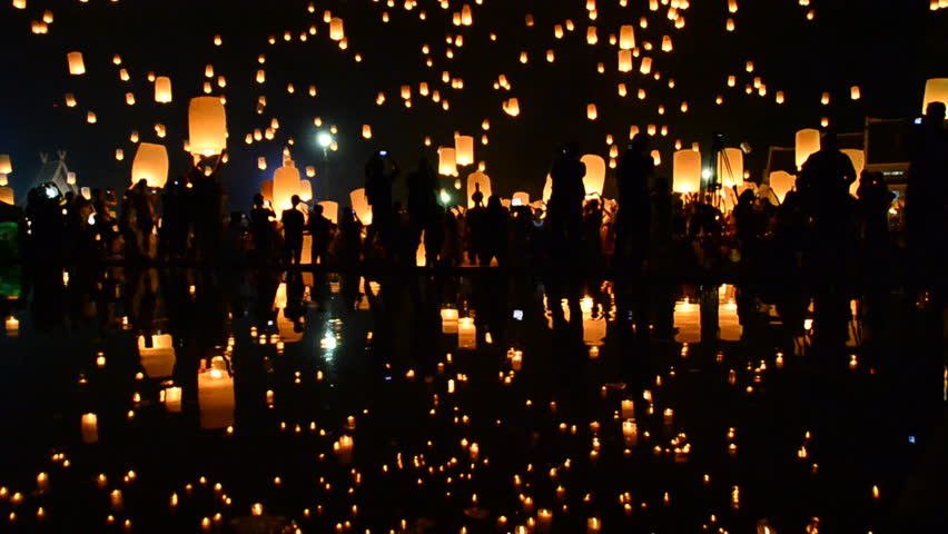 Many Sky Fire Lanterns Floating Up To The Sky In Yee Peng Lanna International 2016 And Reflection on Water Landmark Destination Travel Of Chiang Mai, Thailand (tilt up) | Shutterstock HD Video #22266529