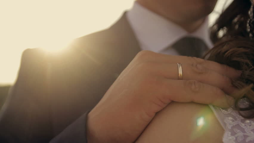 The groom embraces the bride in park in the sun at sunset | Shutterstock HD Video #22440670