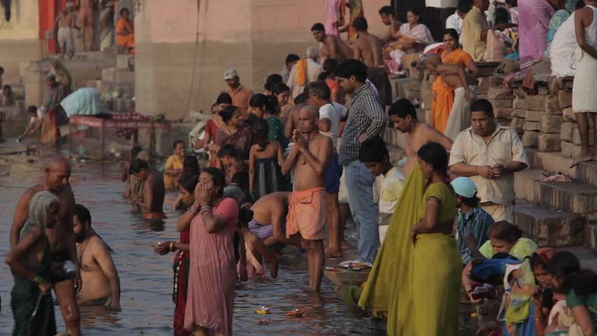 CIRCA 2010: WS Large group of people bathing in Ganges river / Varanasi, India