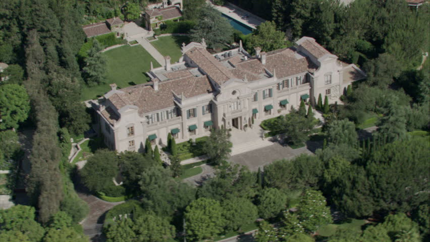 aerial shot of an English country-style manor and the surrounding property