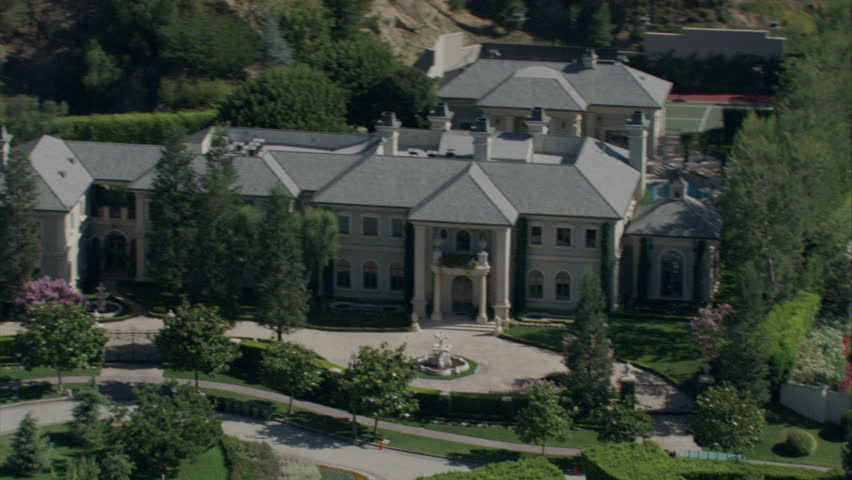 aerial view of a 19th century-style mansion with turrets and a roundabout in the driveway circa 2009 - HD stock footage clip