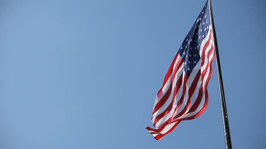 looking at flag pole with American flag waving - HD stock footage clip