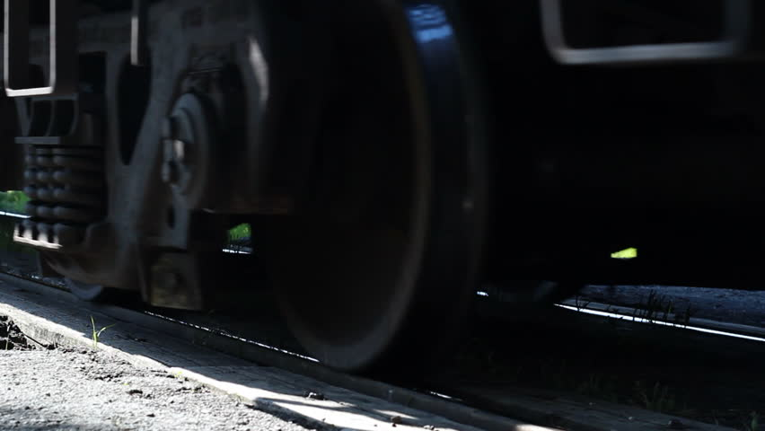 Close up on railway track and cars as they roll past camera/Rail Cars and Track/Close up on railway track and cars as they roll past camera - HD stock footage clip