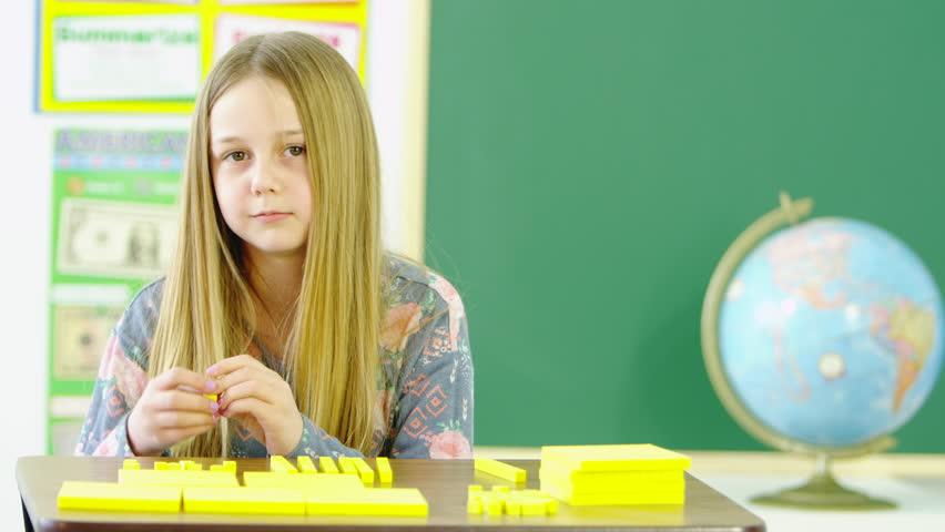 Young girl learning math using blocks | Shutterstock HD Video #22645213