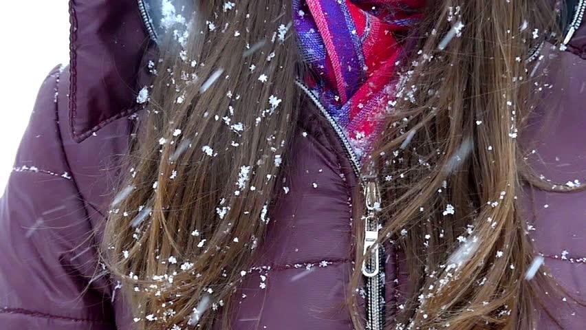 Snowflakes Falling Onbeautiful Girl`s Hair in Slow Motion.   Shutterstock HD Video #22657849