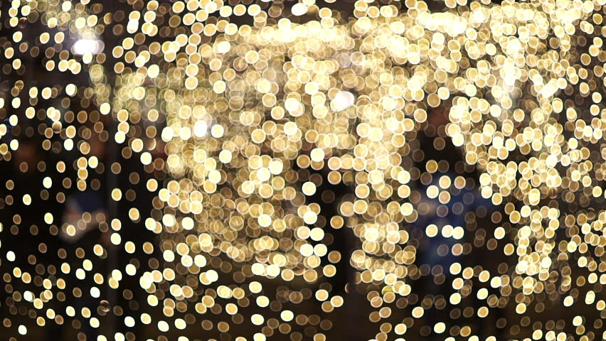 Abstract blurred bokeh blinking lights.  Christmas out of focus setting with silhouettes of people working in the background    Shutterstock HD Video #22661179