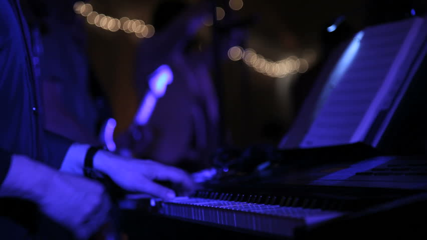 keyboardist playing a synthesizer in a band (no audio) - HD stock footage clip