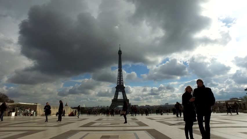 PARIS, FRANCE - CIRCA NOVEMBER 2016: (POV) Panoramic view of Tourists walking at Trocadero in front of Eiffel Tower against blue cloudy sky.  | Shutterstock HD Video #22735834