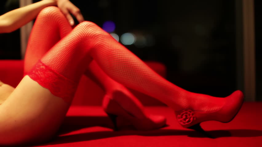 sexy erotic female in a hotel room, close up of her leg in red stockings - HD stock video clip