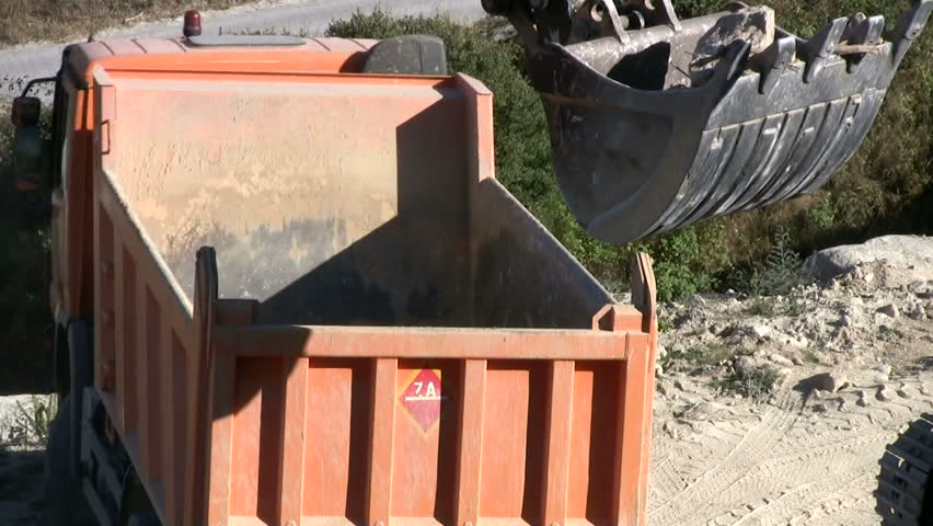 Excavator and truck at construction site - HD stock video clip