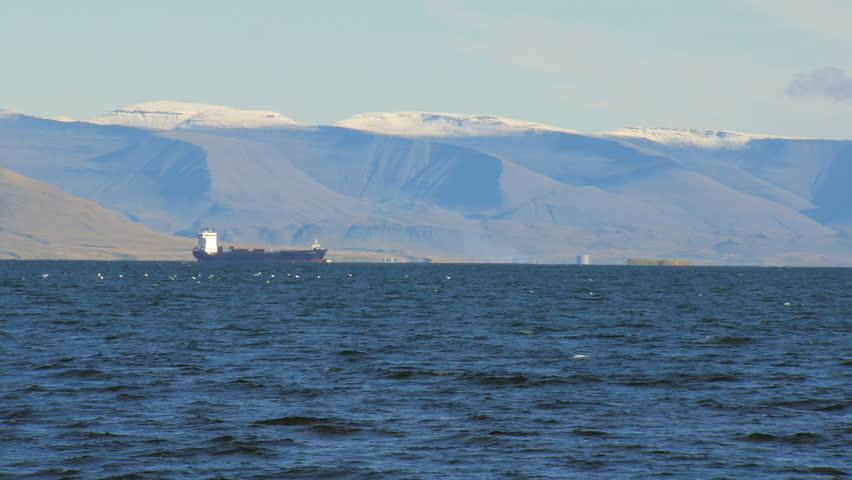 trawler in Atlantic ocean near coast of Reykjavik, snow on the top of mountain #22850071