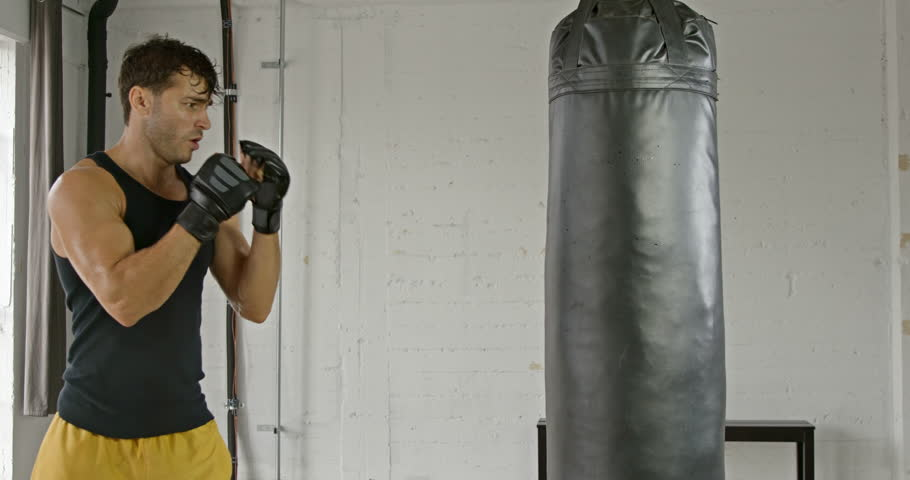 Athletic Male Working Out. Boxing. Slow Motion. | Shutterstock HD Video #22851277