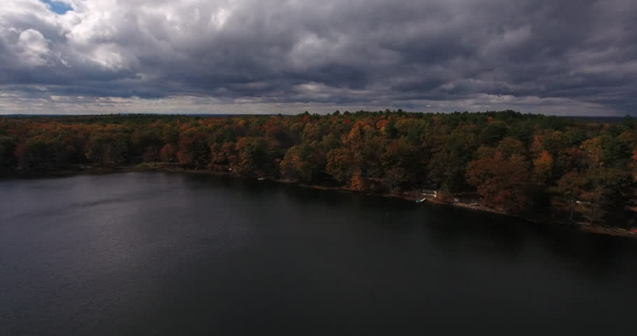 Aerial view of the fall foliage surrounding Lake DeVenoge, in upstate New York. | Shutterstock HD Video #22929874