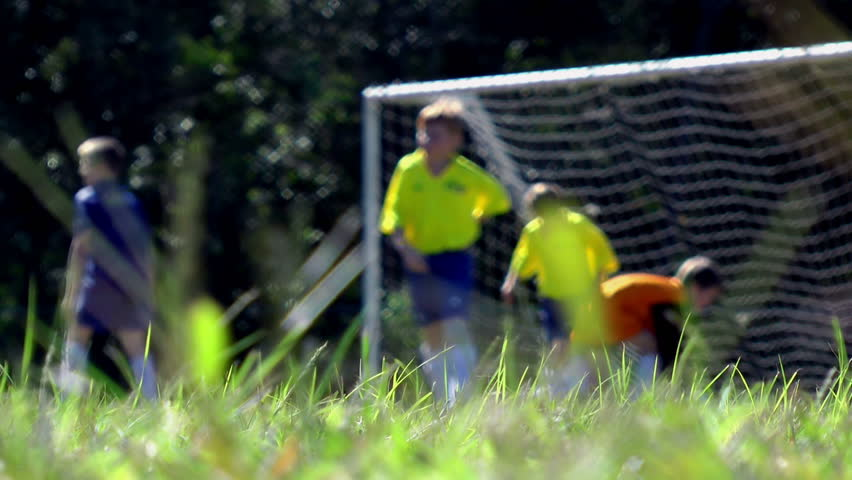 Australia - Saved! Kids playing soccer.