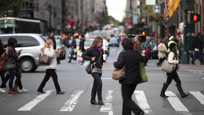 people walking through business district in the city at ...  |Person Walking City
