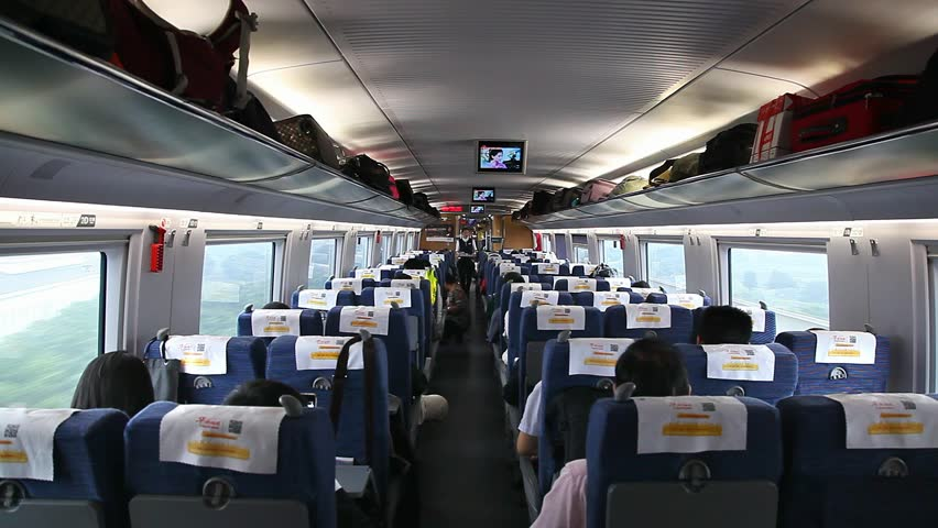 BEIJING, CHINA - SEPTEMBER 27, 2014: Passengers inside of a bullet train on September 27, 2014 in Beijing, China   Shutterstock HD Video #22971571