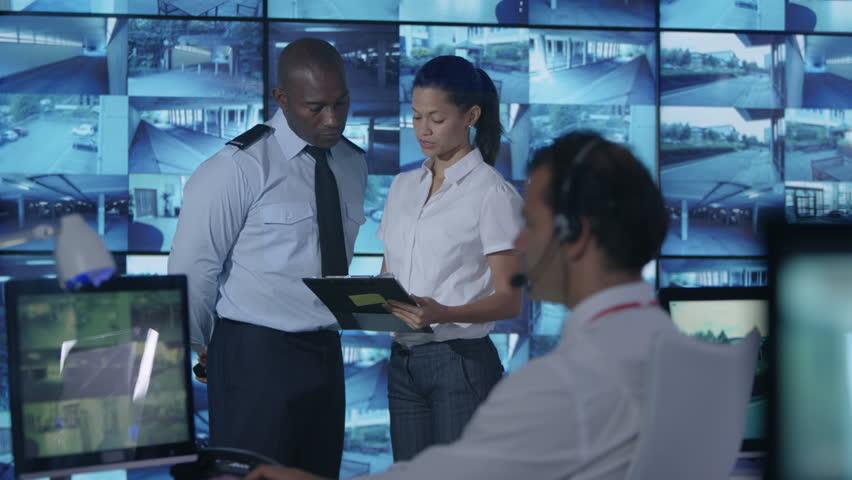 4K Security team watching multiple CCTV video screens in system control room Dec 2016-UK   Shutterstock HD Video #23015734