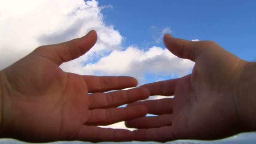 Hands covering camera lens reveal cloudscape concept. - HD stock video clip