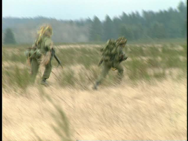 Army troops running to firefight (BetacamSP no audio) - SD stock footage clip