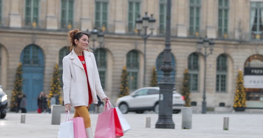 Paris, Woman shopping in Paris on place Vendome, 4K, UHD (3840X2160) | Shutterstock HD Video #23074477