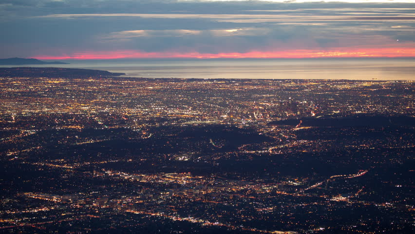 4K time lapse high angle wide shot of the Los Angeles basin city lights and the Pacific Ocean coastline at sunset from a high altitude vantage point on a very clear evening | Shutterstock HD Video #23086006