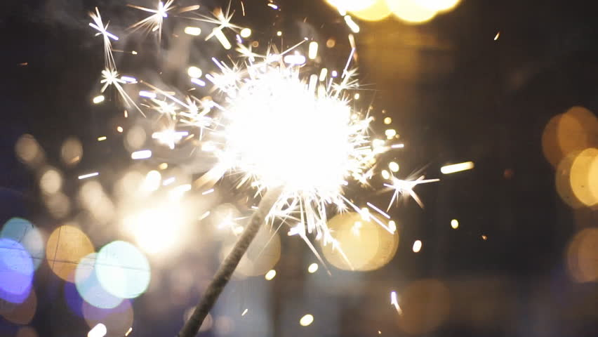 Sparklers burn at the background of the city. | Shutterstock HD Video #23104618