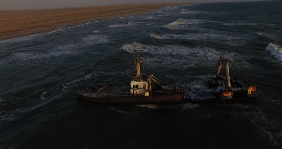 Drone video aerial view of Namibian Atlantic coastline, Zeila L-758 Walvis Bay shipwreck and sand beach, surf break line, Skeleton Coast Park landscape with ocean background at Namibia's west coast   Shutterstock HD Video #23108461
