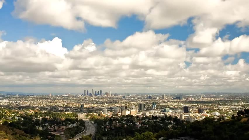 Los Angeles in Cloudy Weather. a View of the Wide Road, the Road Goes a Lot of Cars. on the Side of the Road Grow Green Trees. Far on the Horizon Visible High Skyscrapers. View of Los Angeles From a | Shutterstock HD Video #23112340