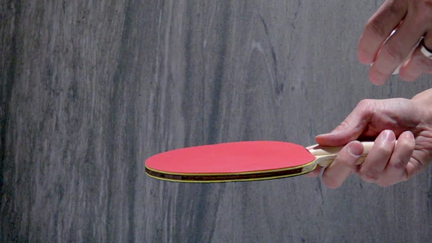 Hand holding table tennis racket and serve ping pong ball. Slow motion film clip with sport equipment. | Shutterstock HD Video #23115535