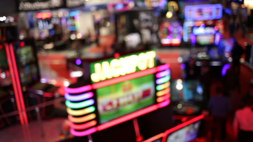 Blurry image of slots machines and other gambling equipment at a casino. Out of focus (bokeh) colourful and high contrast picture in a casino. | Shutterstock HD Video #23122915