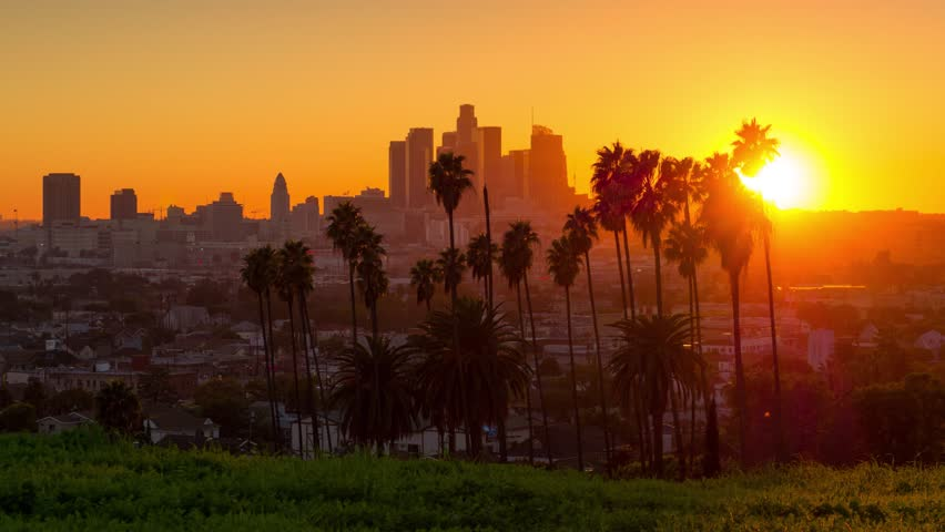 Scenic sunset to night transition city of Los Angeles downtown skyline palm trees in foreground. 4K UHD timelapse. | Shutterstock HD Video #23151445